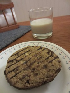 Cowboy Cookies with glass of almond milk