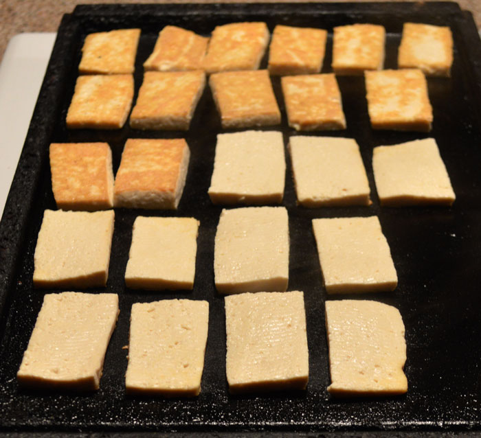 tofu cooking on the griddle