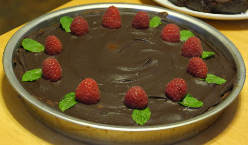 vegan chocolate cheesecake with raspberry