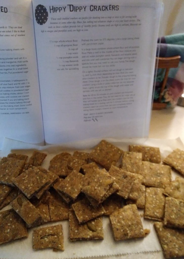 seedy crackers in front of cracker recipe
