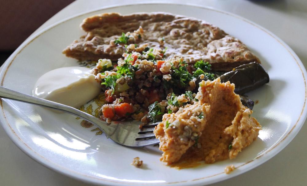 Plate of vegan tabbouleh, bread, yogurt and dolmas