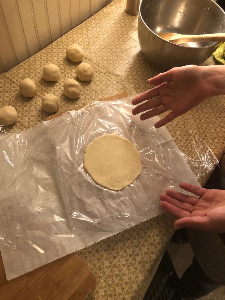 pressing corn tortillas