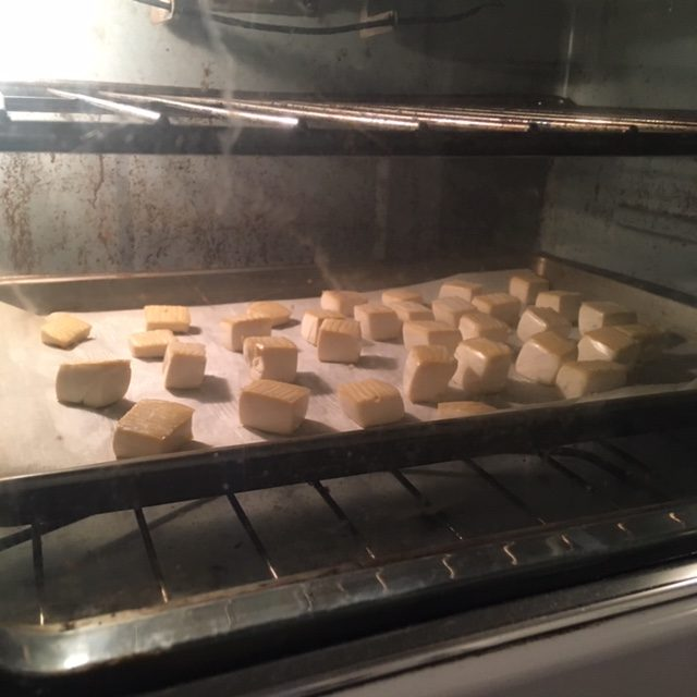 tofu baking in an oven