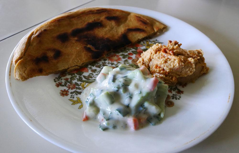 vegan yogurt cucumber salad with hummus and bread