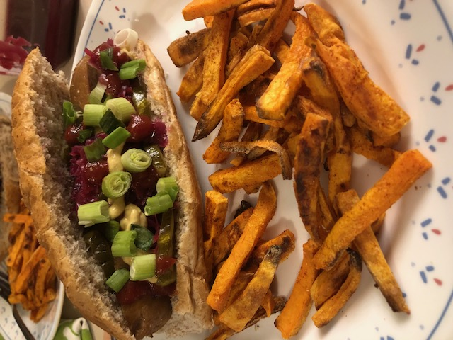 "vegan ""not hog"" with ketchup and green onion with fries"