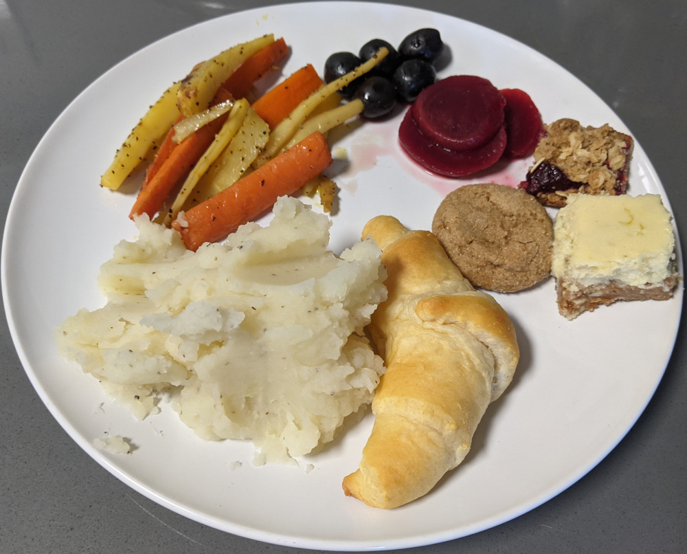 mashed potatoes, crescent roll, carrots and parsnips, cranberry sauce, and cookies