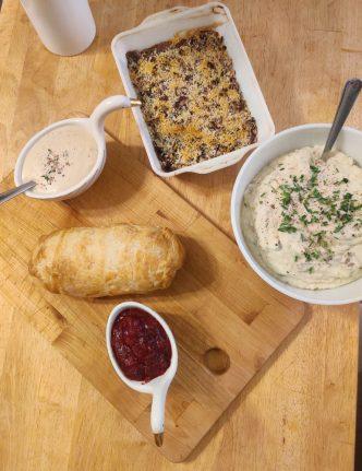 gravy boat, field roast, cranberry sauce, mashed potatoes, green bean casserole