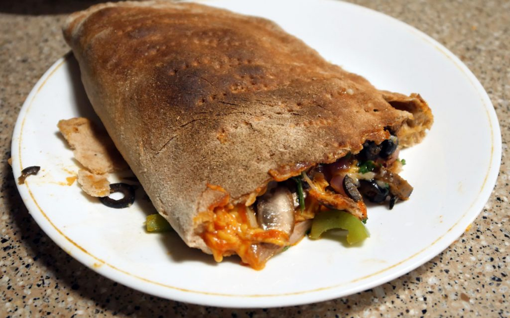 vegan calzone baked and cut open