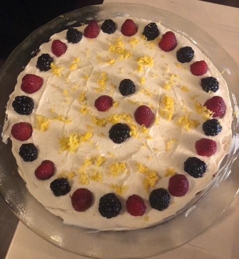 ice box pie decorated  with raspberries, blackberries, and lemon zest
